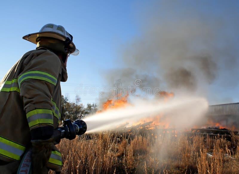 Het tegenhouden van de Brand stock afbeeldingen