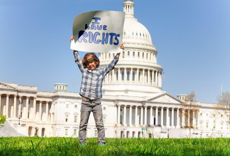 Het teken die van de protesteerderholding heb ik rechten zeggen royalty-vrije stock fotografie