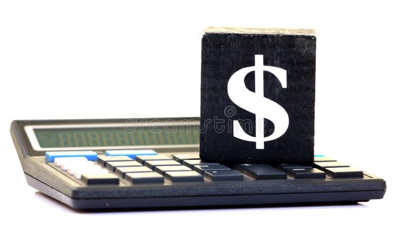 Het teken en de calculator van de dollar stock afbeelding