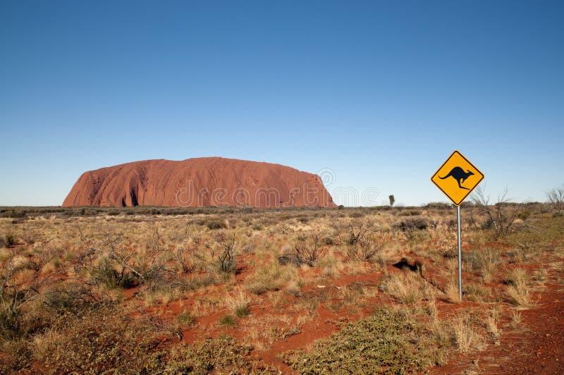 Het teken en Uluru van de kangoeroe royalty-vrije stock foto's