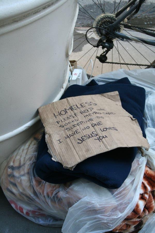Het Teken van de dakloze Persoon op NYC-straten royalty-vrije stock afbeeldingen