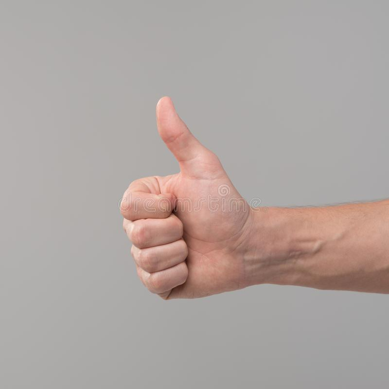 Het teken van de hand beduimelt omhoog royalty-vrije stock afbeelding