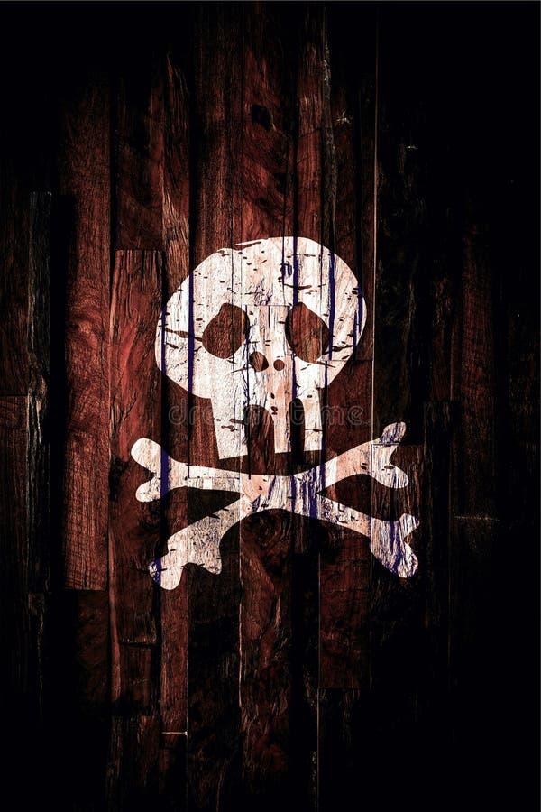 Het teken van de piraatschedel op hout wordt geschilderd dat stock afbeeldingen