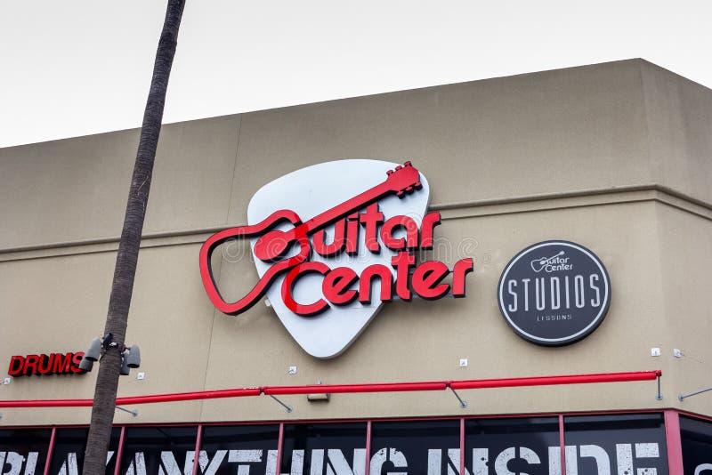 Het teken van het gitaarcentrum stock foto's