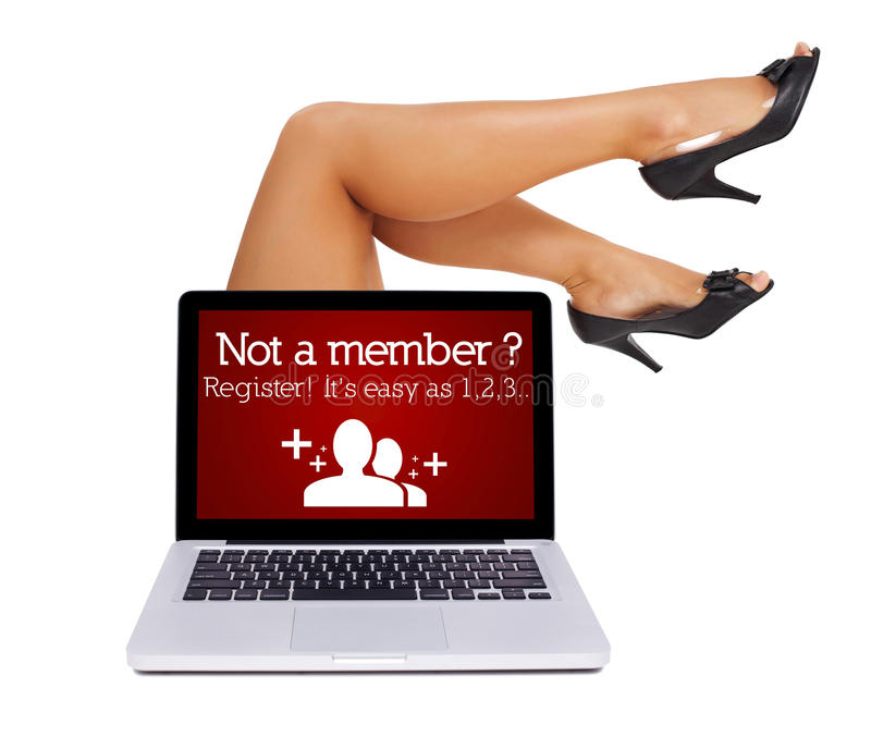Het teken van het register in laptop met sexy voeten royalty-vrije stock foto