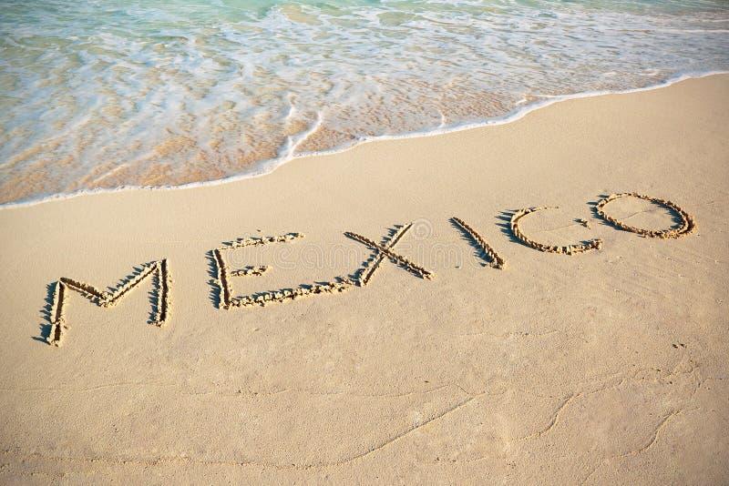 Het teken van Mexico op het strand stock foto