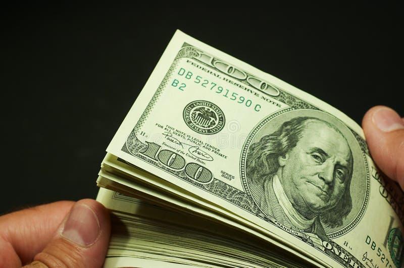 Het tellen van het contante geld - de dollars van de V.S. royalty-vrije stock fotografie