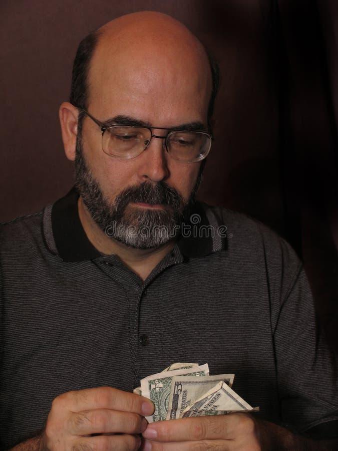 Het Tellende Geld van de mens royalty-vrije stock foto's