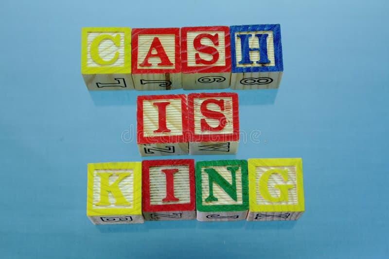 Het term contante geld is koning stock afbeelding