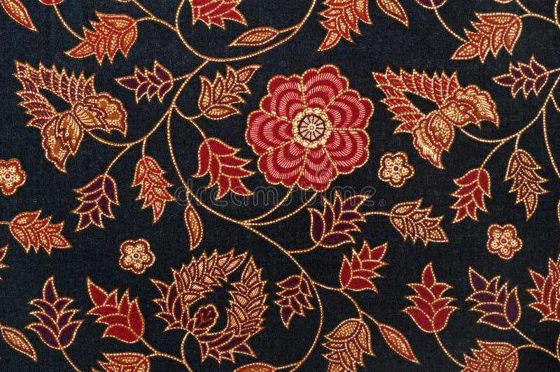 Het textielpatroon van de batik met zwart en rood stock afbeeldingen