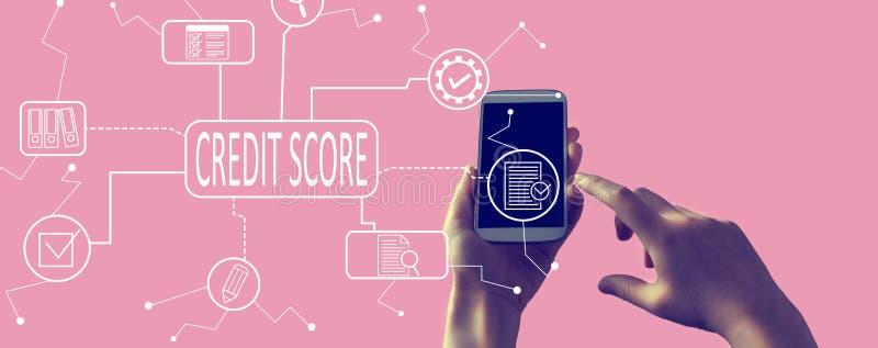 Het thema van de kredietscore met smartphone royalty-vrije stock foto