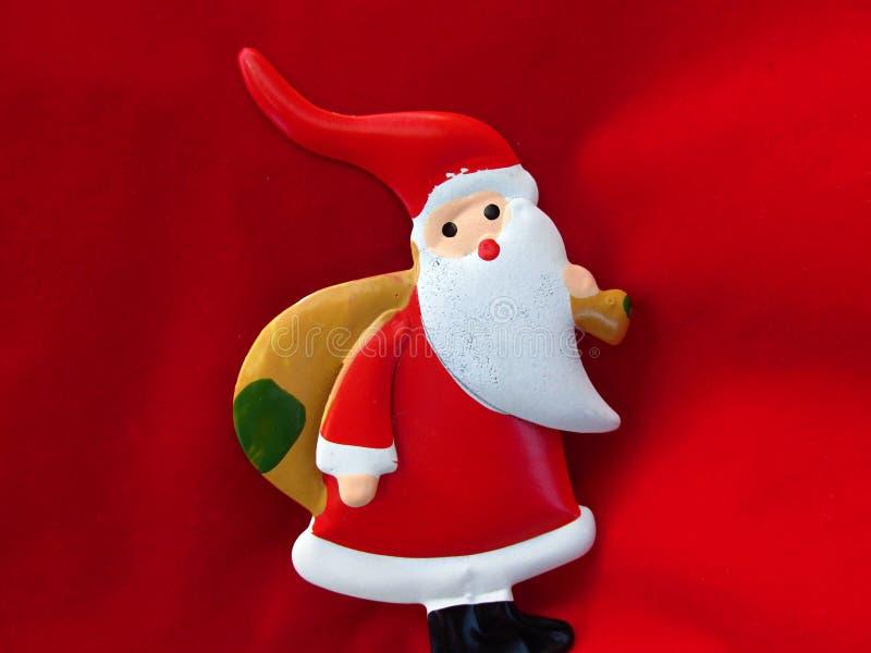 Het thema van het Kerstmisseizoen met Santa Claus op rode achtergrond royalty-vrije stock afbeelding