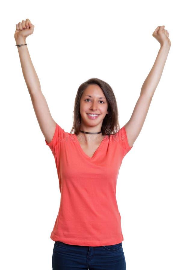 Het toejuichen van jonge vrouw in een rood overhemd stock foto's