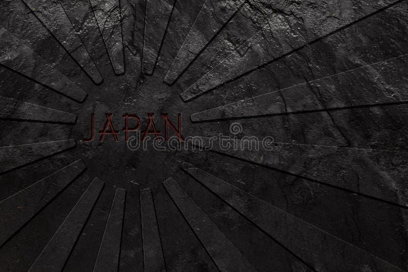Het toenemen de vlag van Zonjapan in zwarte leisteen die wordt gesneden royalty-vrije stock fotografie