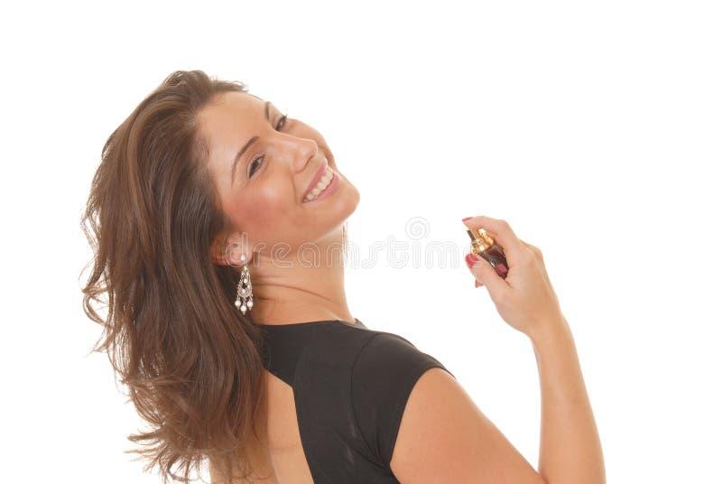 Het toepassen van Parfum stock afbeeldingen