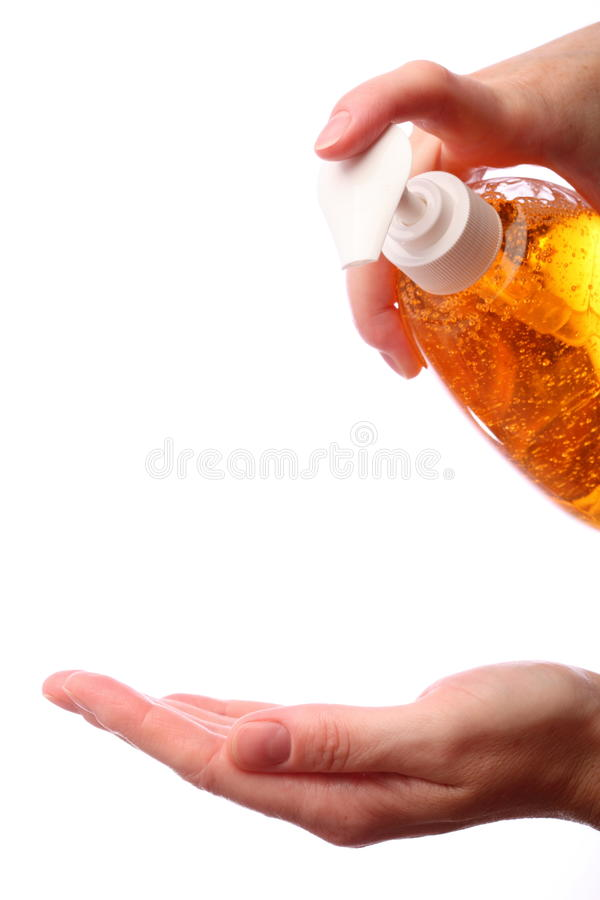 Het toepassen van vloeibare zeep voor handwas royalty-vrije stock foto