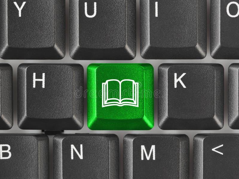 Het toetsenbord van de computer met de sleutel van het Boek royalty-vrije stock afbeelding