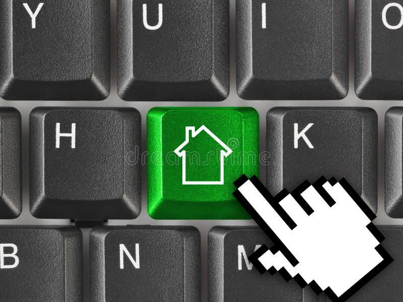 Het toetsenbord van de computer met de sleutel van het Huis stock afbeelding