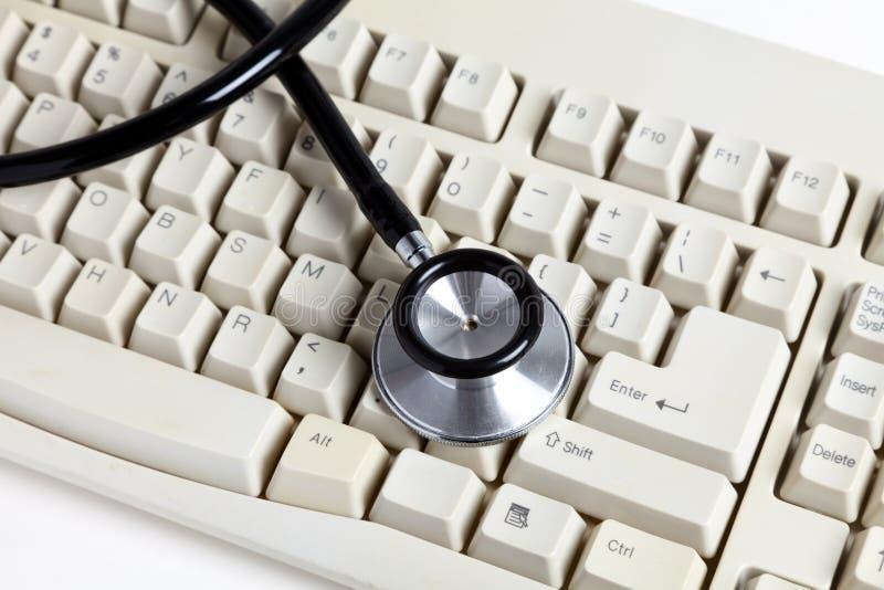 Het toetsenbord van de stethoscoop en van de computer stock afbeeldingen
