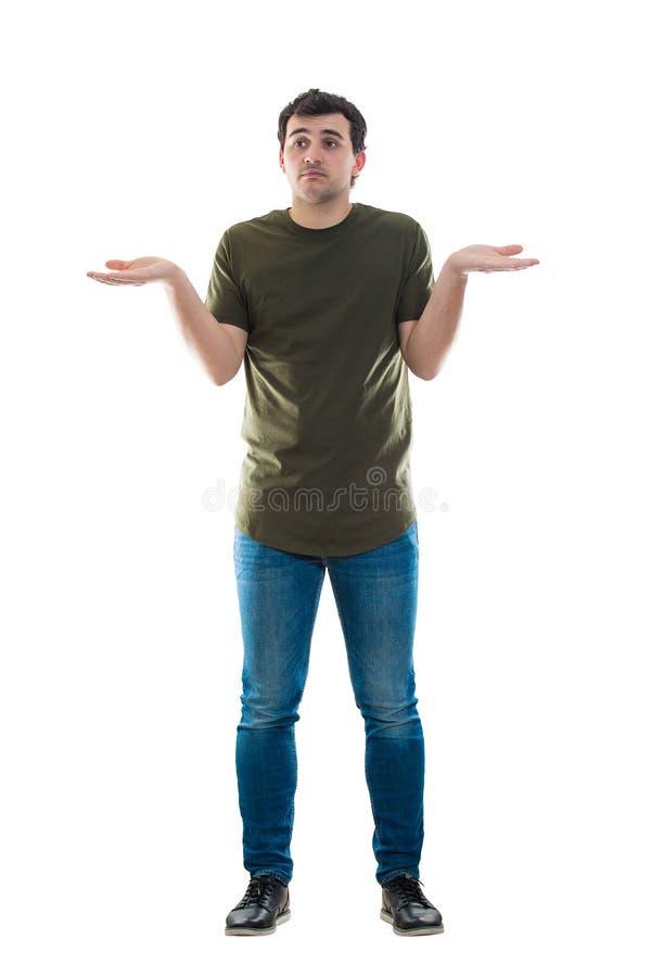 Het toevallige mannetje haalt hulpeloos gebaar op stock foto's