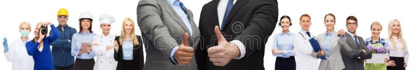 Het tonen van de zakenman en van de onderneemster beduimelt omhoog stock afbeelding