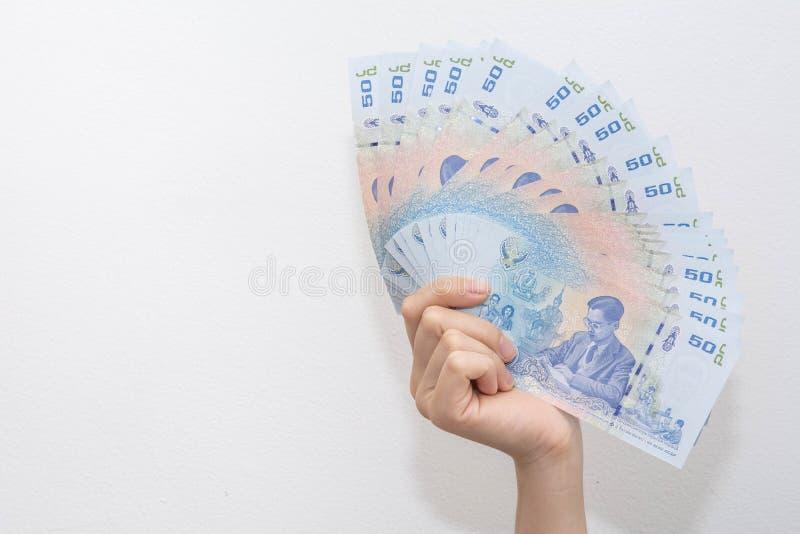 Het tonen van geldbankbiljetten op wit royalty-vrije stock foto's