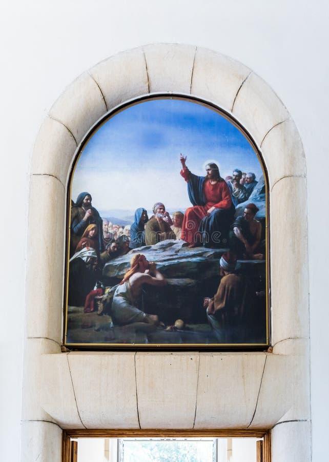 Het trekken op de muur met een perceel, als Jesus predikt aan mensen over de uitgang aan het Gelukzaligheidklooster op de berg o  stock foto's