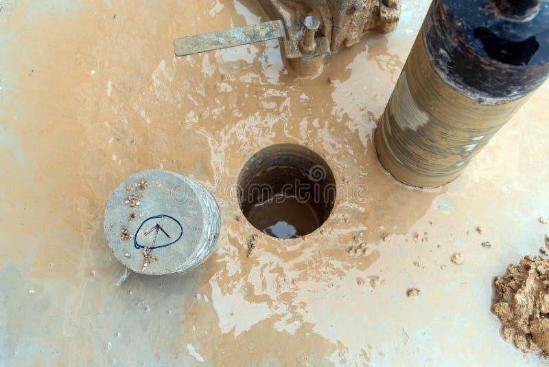 Het uitboren van machine in bouwwerkzaamheid stock foto