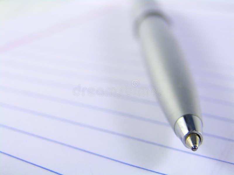 Het uiteindemacro van de pen op papier royalty-vrije stock afbeelding