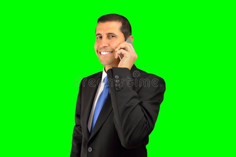 Het uitvoerende spreken telefonisch royalty-vrije stock afbeelding