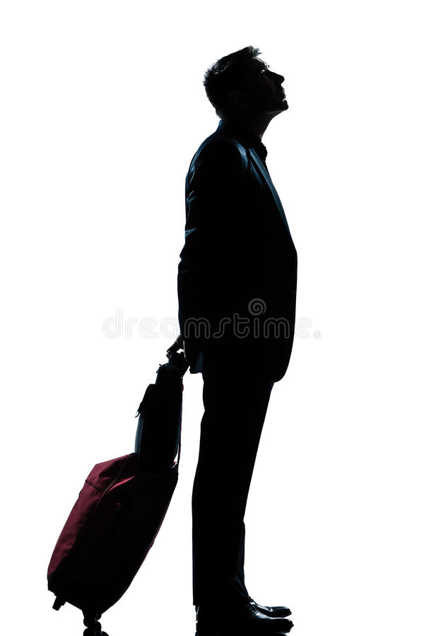 Het van de bedrijfs mens reiziger wachten die omhoog eruit ziet stock fotografie
