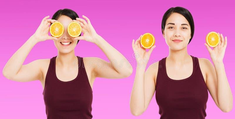Het vastgestelde Aziatische meisje met mooie duidelijke huid houdt vruchten op purpere achtergrond - gezondheid en gewichtsverlie stock fotografie