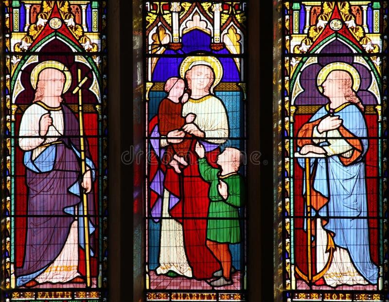 Het venster van het de Liefdadigheidsgebrandschilderde glas van de geloofshoop royalty-vrije stock foto's