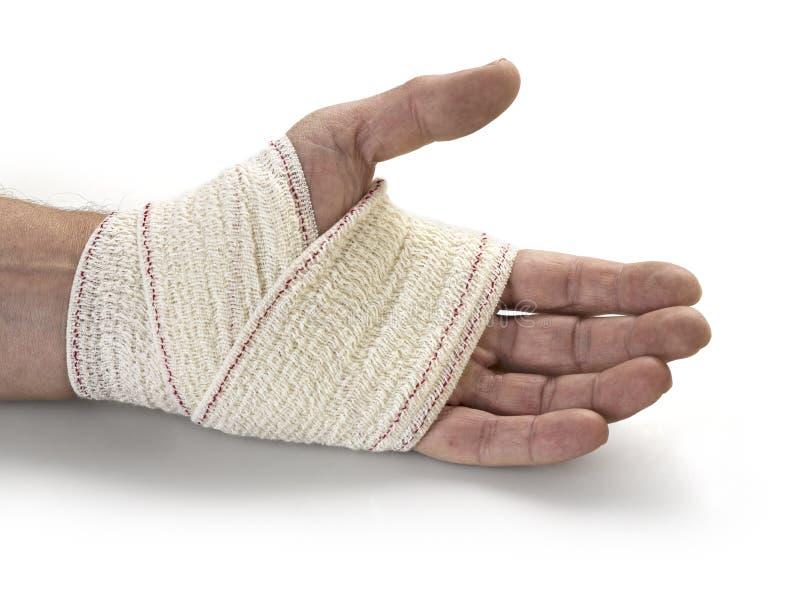 Het verband van de geneeskunde op menselijke hand stock fotografie
