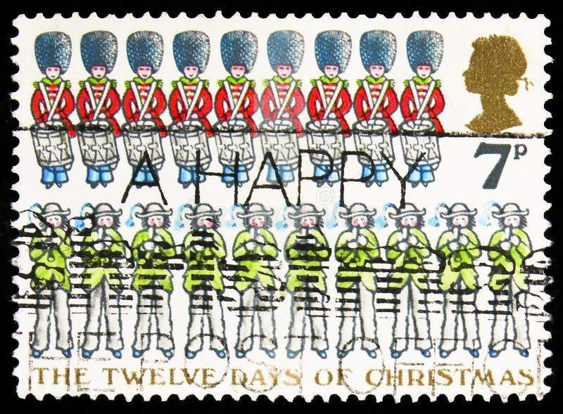 In het Verenigd Koninkrijk gedrukt postzegel toont Ten Pipers Piping etc., Kerstmis 1977 - De twaalf dagen van de kerstserie, ong royalty-vrije stock fotografie