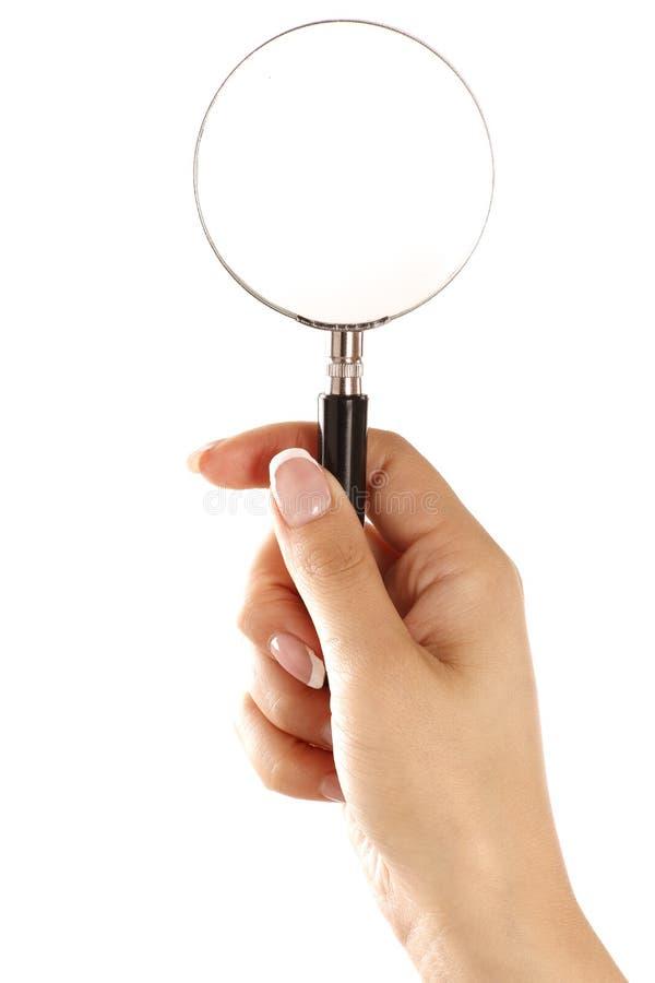 Het vergrootglas van de handholding op witte achtergrond wordt geïsoleerd die royalty-vrije stock afbeeldingen