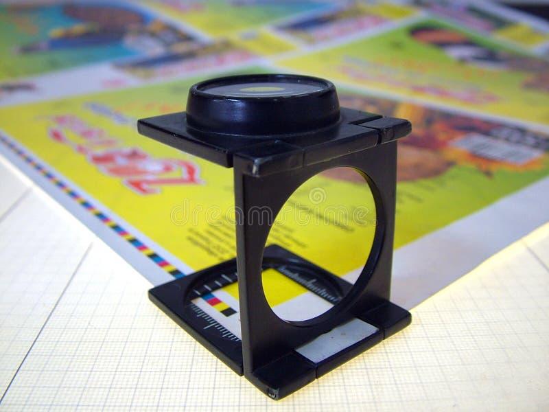 Het vergrootglas van de pers royalty-vrije stock afbeelding