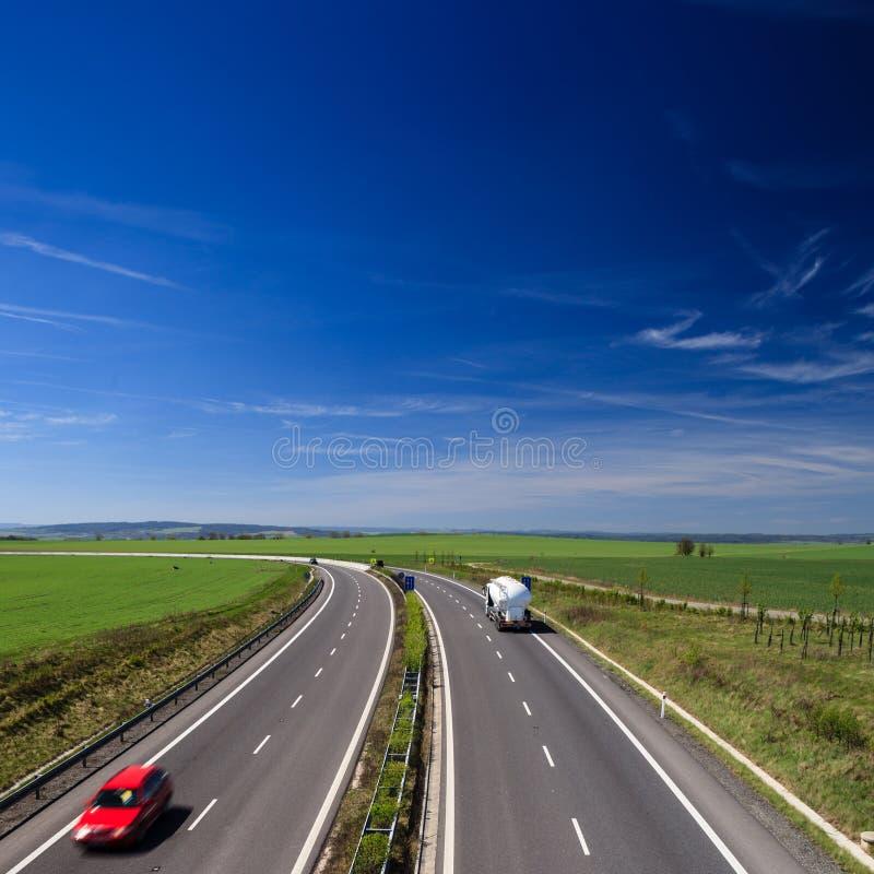 Het verkeer van de weg stock afbeelding