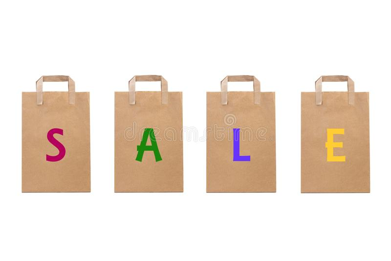 Het verkoopwoord schrijft in verschillende document zakken stock foto