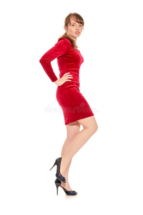Het verleidelijke meisje in de rode stiekeme kleding stock afbeelding