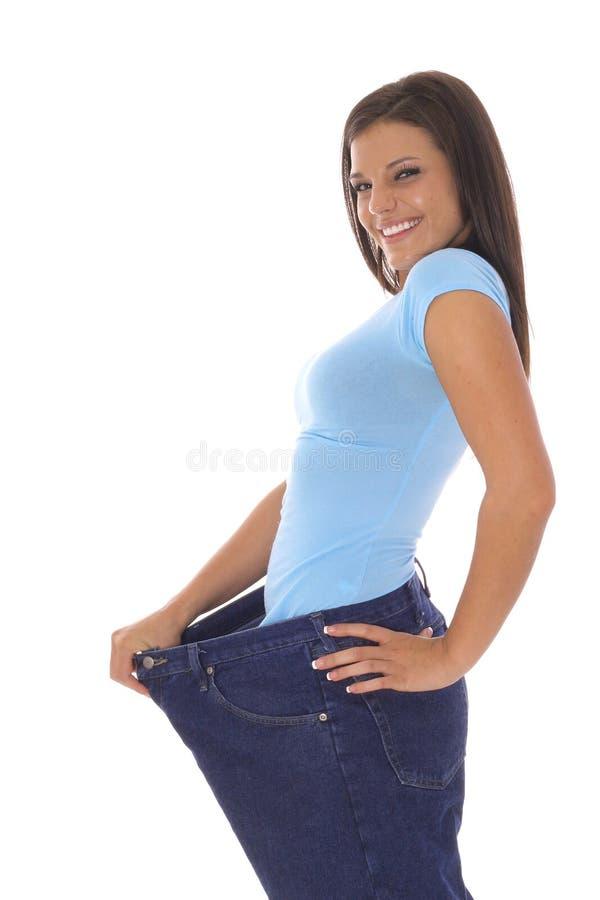 Het verliesjeans van het gewicht stock afbeelding