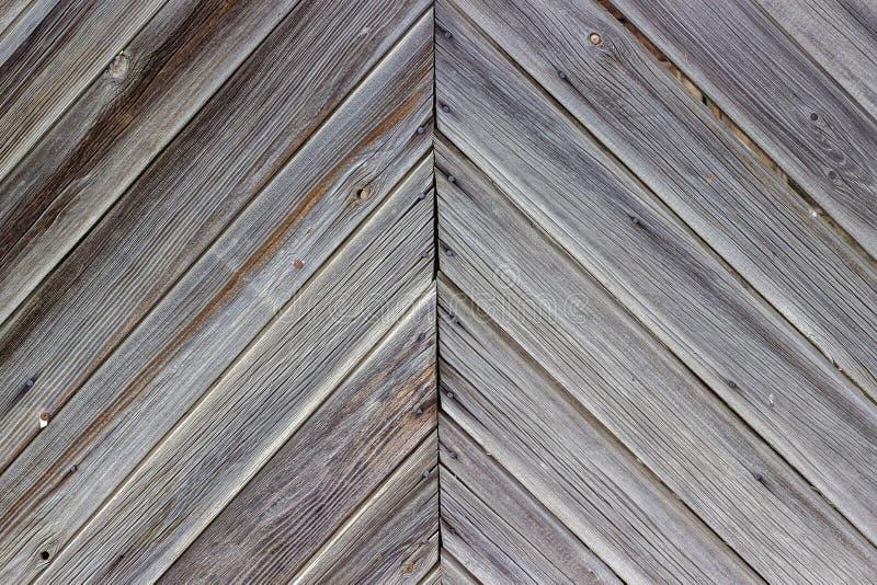 Het verouderen van muur van het houten gebouw als achtergrond of textuur stock foto's