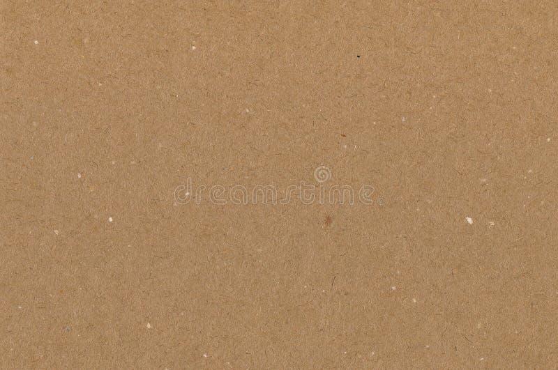 Het verpakken document bruine kartontextuur, natuurlijke ruwe geweven exemplaar ruimteachtergrond, horizontale donkere tan, geel, royalty-vrije stock afbeelding