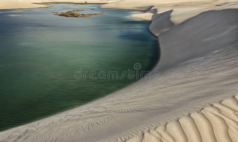 Het verplaatsen van Zand stock foto
