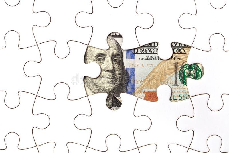 Het verzamelen van dollarbankbiljet met puzzel royalty-vrije stock fotografie