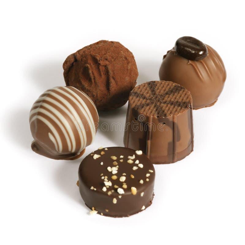 Het verzamelen zich van de chocolade stock foto's