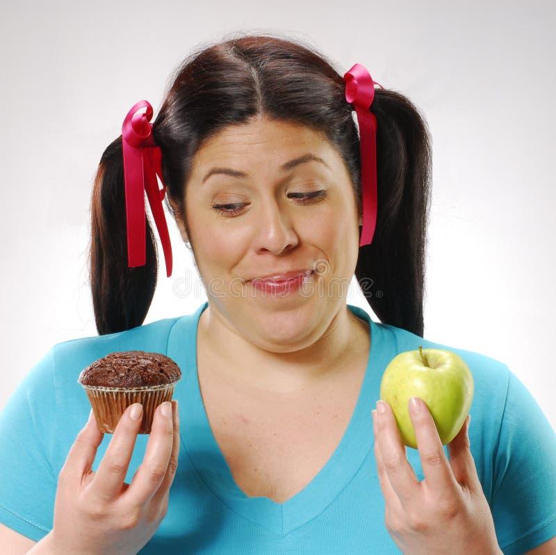 Het vette vrouw op dieet zijn. royalty-vrije stock afbeeldingen