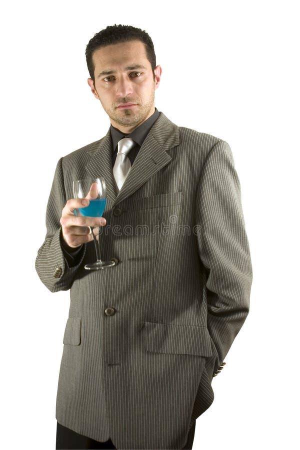 Het vieren van de zakenman met een glas van drank stock fotografie
