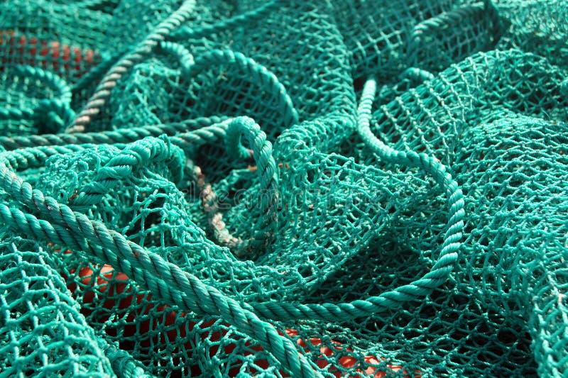 Het visnet vast door een kabel stock fotografie