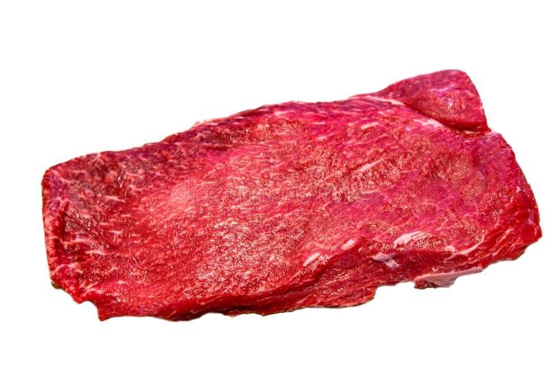 Het vlakke ijzerlapje vlees ligt op een witte achtergrond royalty-vrije stock foto